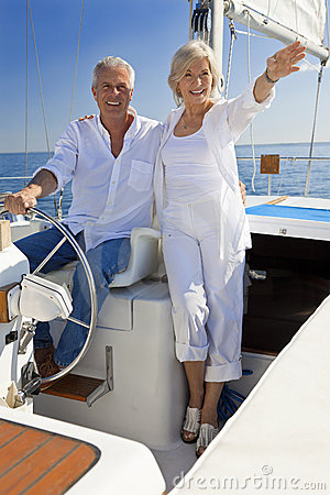 happy-senior-couple-wheel-sail-boat-20954981